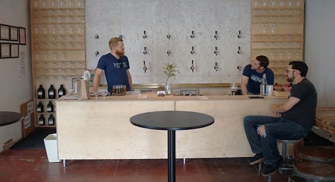 Beer enthusiasts discuss beer ingredients and styles at Home Brew Co.
