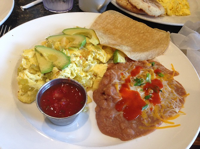 The Southwestern Scramble: eggs with chilies, onions, and pepper jack cheese. Cholula hot sauce on the refried beans optional.