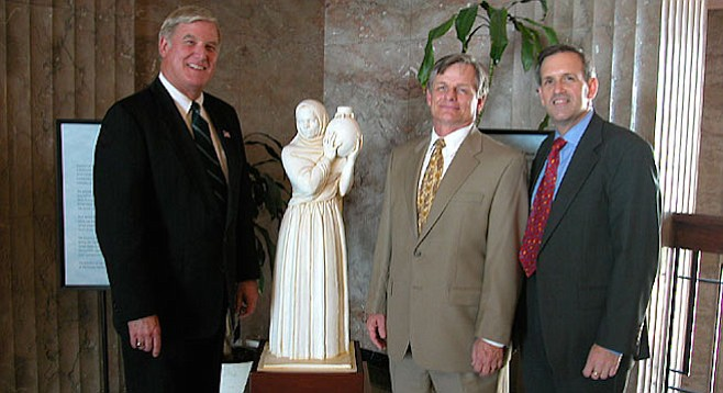 County supervisor Greg Cox, clerk Thomas Pastuszka, and John Wadas, executive director of the San Diego Historical Society flank a Donal Hord sculpture (Guardian of the Water) March 12, 2003.