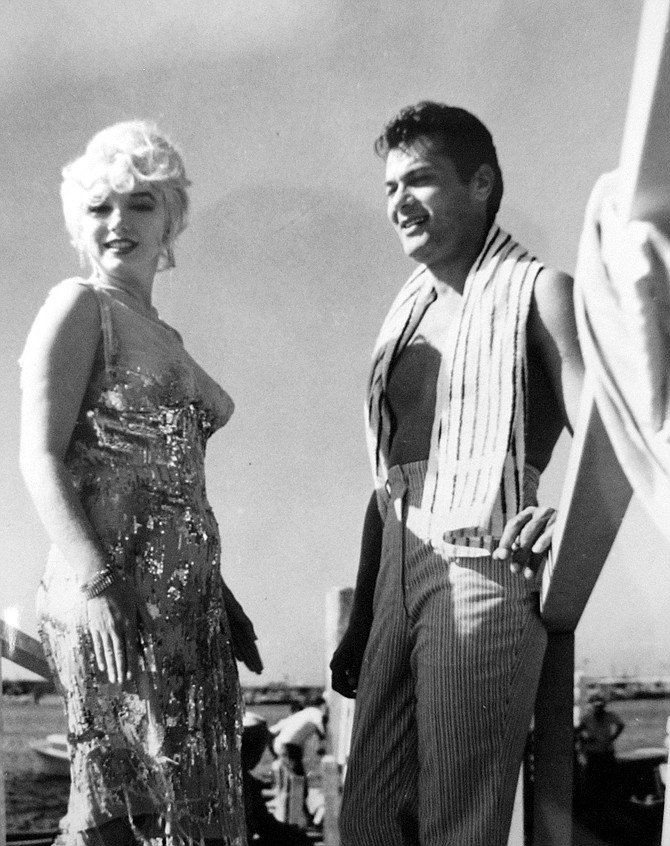 Marilyn Monroe and Tony Curtis (between takes). Tony Curtis falls in love with the band's lead singer played by Monroe.
