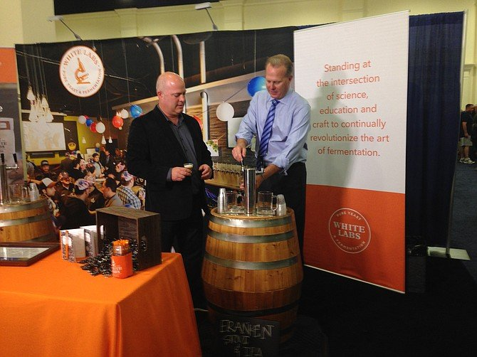 Mayor Kevin Faulconer pours White Labs beer for attendees of June's National Homebrewers Conference, while White Labs CEO Chris White looks on.