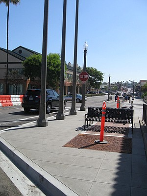 Some may see it as a bottleneck, but the city sees it as a balancing measure between vehicles and pedestrians.