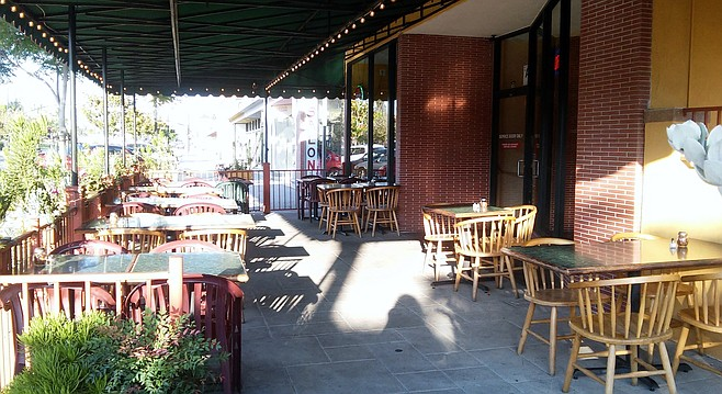 People-watch and dine on the outdoor patio