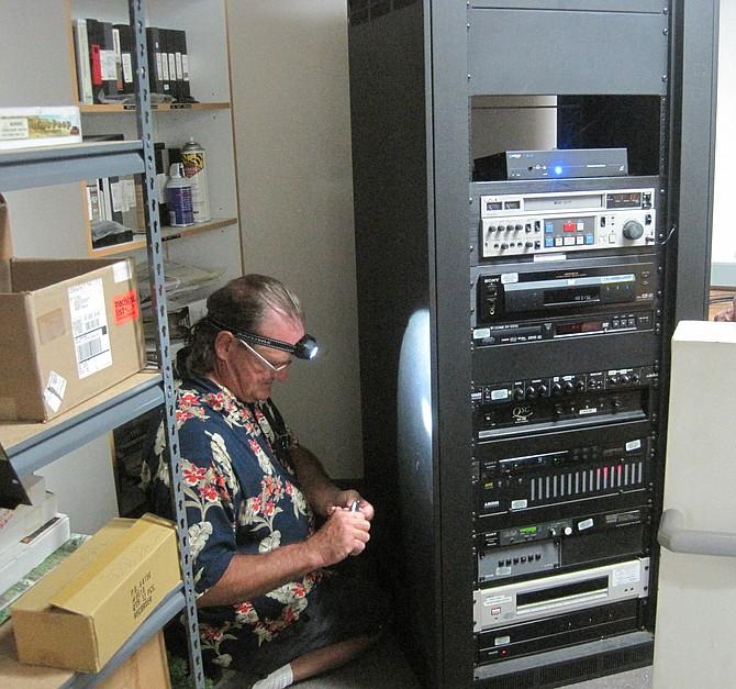Rick Goddard installs hearing-loop technology at Mission Trails Regional Park visitor center