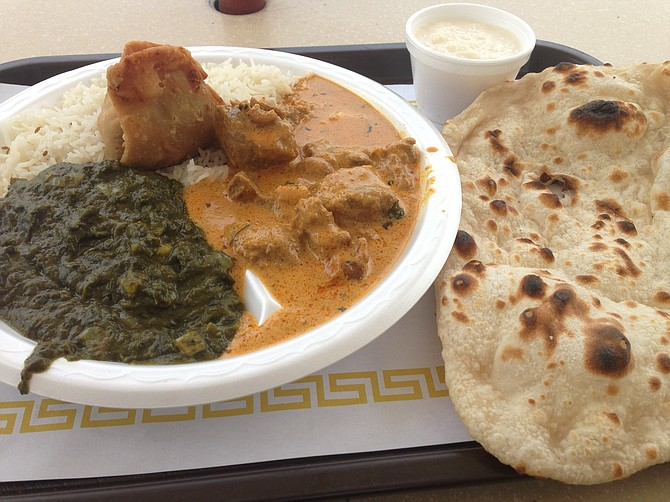 One vegetable samosa plus rice, raita, naan, lamb curry, and that old spinach standby, saag