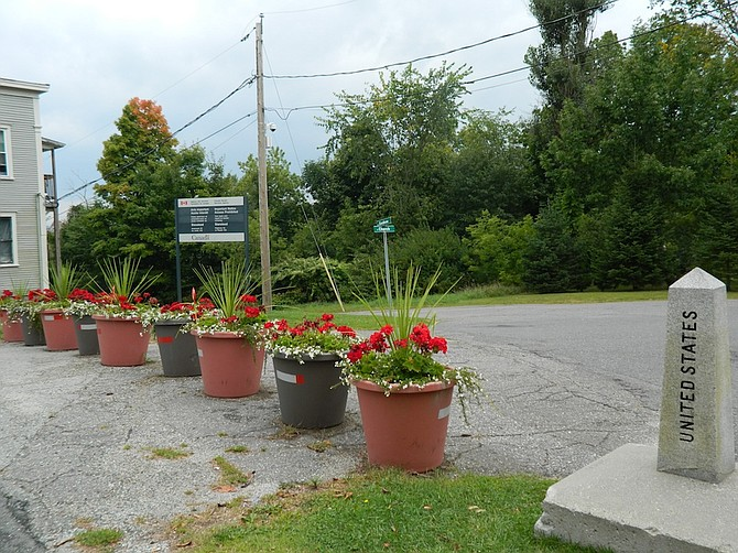 The border between Derby Line, VT, and Quebec Province is guarded by flowers.