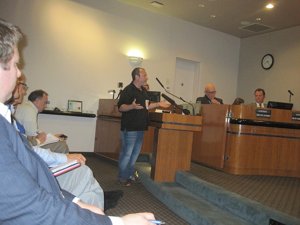 Aaron Amerling testifies at May 20 hearing; Bill Chopyk is on the far right on the dais.