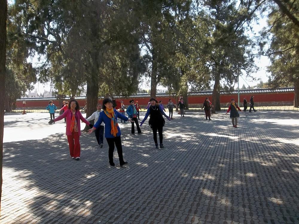 Beijing women line dancing in the Temple of Heaven complex.
