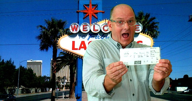 A happy author with his boarding pass, and green-screen generated Vegas sign