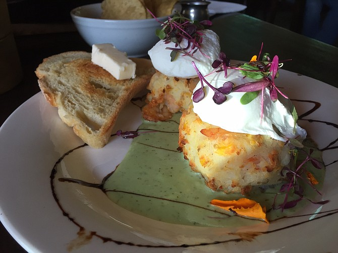 Pretty shrimp corn cakes with poached eggs on a cilantro cream sauce