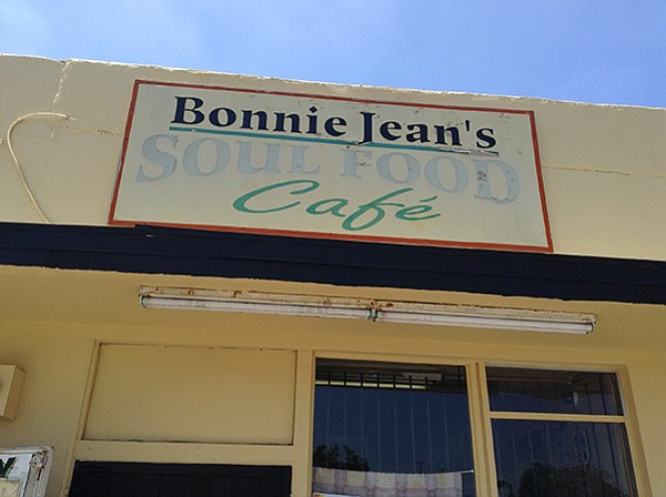 Sun-faded sign above Bonnie Jean's