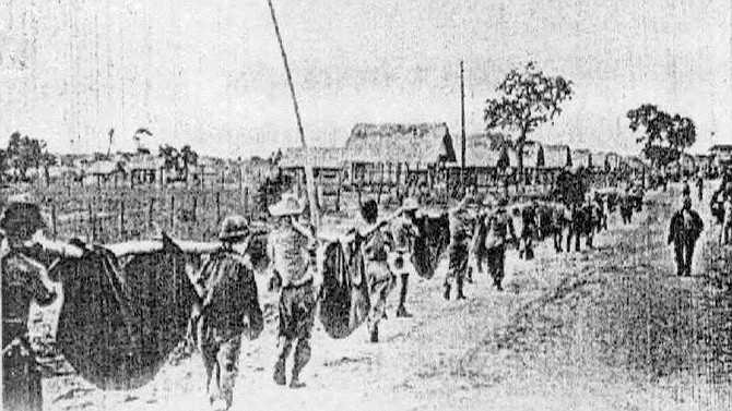 Carrying the dead, Camp O'Donnell. The latrines soon overflowed, and disease was epidemic.