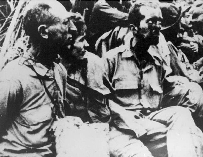 """POWs, Bataan Peninsula, Philippines. """"They tried to hit any prisoner who was not marching fast enough."""""""