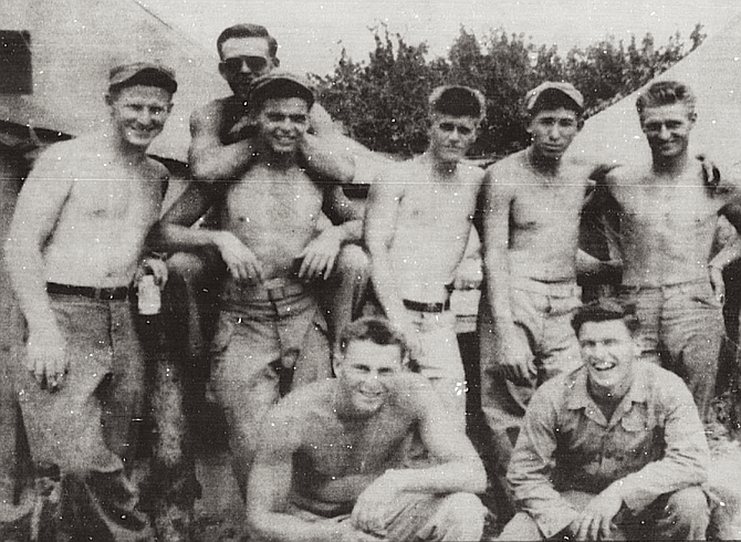 """Members of B Company, 1st Marine Division, 1st Motor Transport Battalion, Korea (Robert Weishan at far left). Weishan: """"There were terrible problems with high tides — at Inchon they ran 18 to 20 feet."""""""