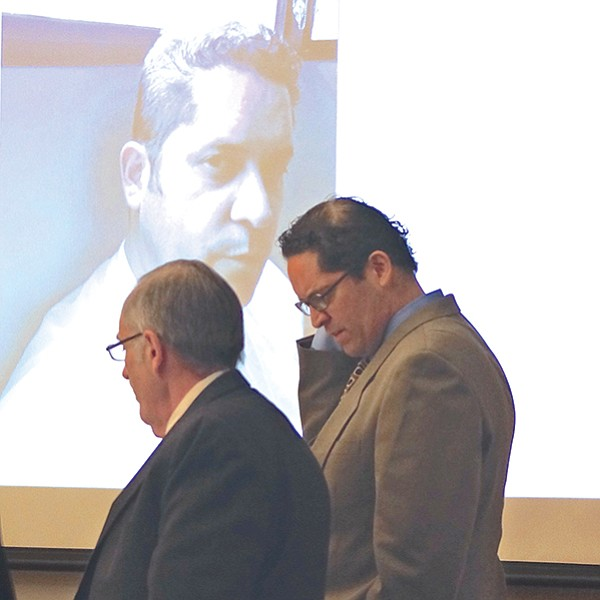 Attorney Weston with Rodriguez and evidence photo displayed in court