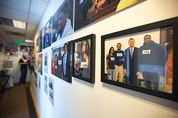 Photos of successful exonerations line the hallways of the California Innocence Project office.