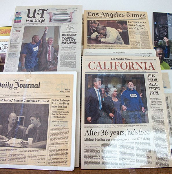 Newspaper clippings from past Innocence Project cases