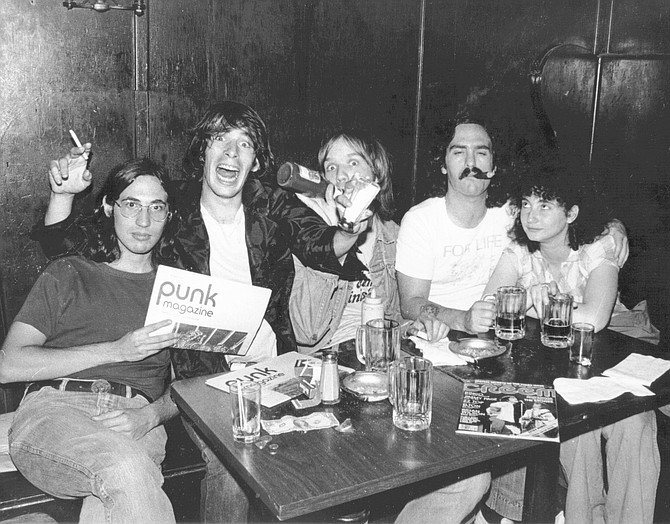 Billy Altman, Legs McNeil, John Holstrom, the author, and Rosa Hoffman, 1976.  Right now I'm reading Please Kill Me, the Leggs McNeil/Gillian McCain oral punk thing.