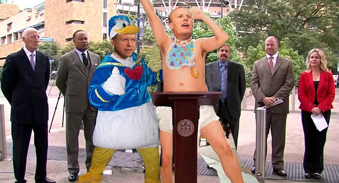 "Faulconer and Goldsmith — in Charger-mandated diaper and Donald Duck suit, respectively — accuse team management of ""unserious"" attitude."