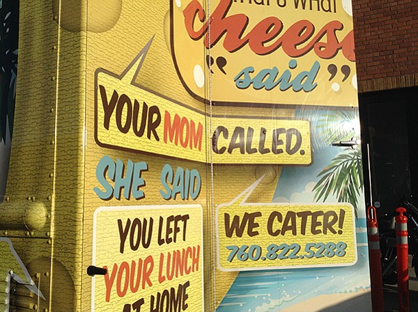 Truck has crazy familiar messages to look at while you wait for your burger and cheese fix