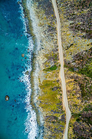 An aerial perspective of Hwy 1 and the majestic Big Sur Coastline.