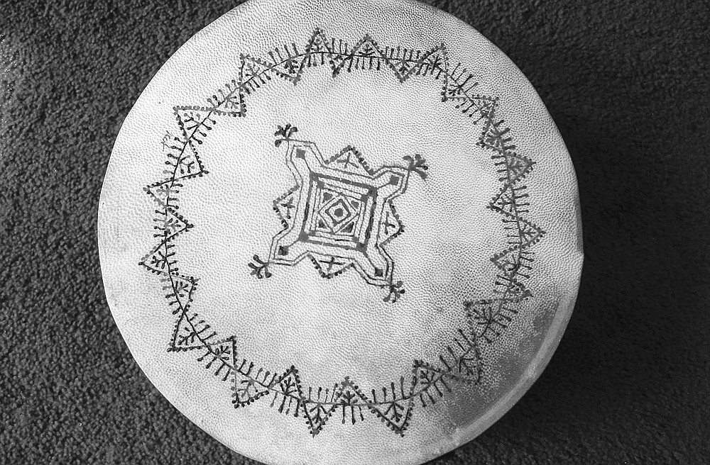 Pakistani drum decorated by Papousek with henna in Moroccan design. Her favorite memory of doing henna continues to be the time she drew on the pregnant belly of a woman.