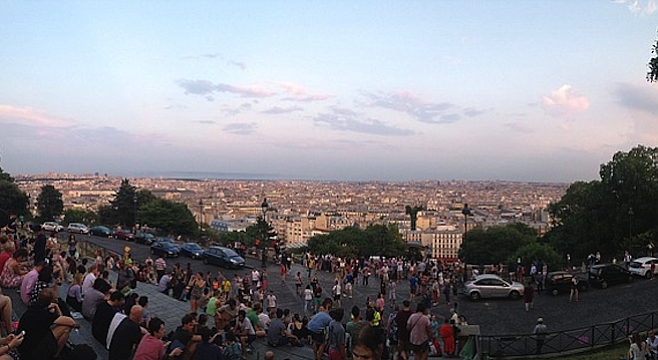 Crowds gather to take in the view at Paris's Sacré-Cœur basilica, the highest point in the city.