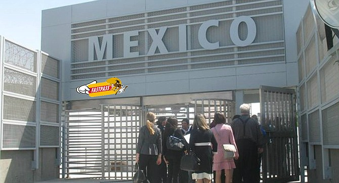 Pedestrians wait in line to pass through Mexico's new East Gate facility, apparently unmoved by Speedy Gonzales' promise of available rapid entry.