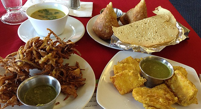 The meal: pakoras, dhal soup, samosas, papadum, and paneer pakauda, all for about $15