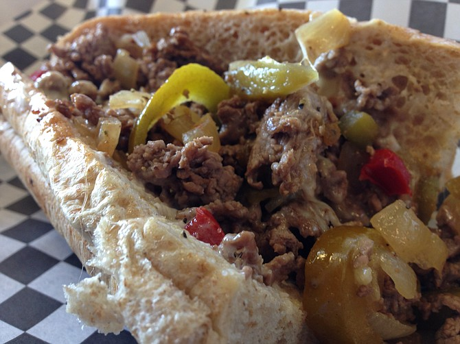 Cheesesteak on a wheat roll with grilled onions and peppers and per recommendation, a little mayo