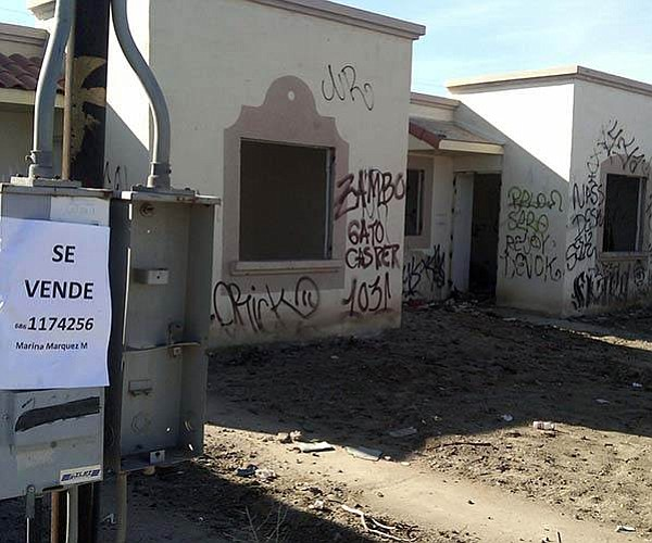 Unable to make payments, owners have abandoned homes like these across Baja.