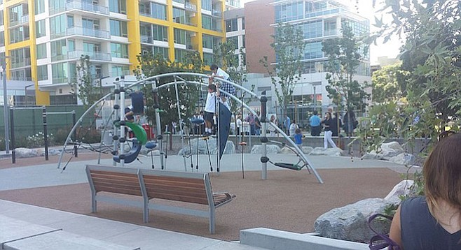 Playground at Fault Line Park (yellow-accented Pinnacle at the Park building in background)