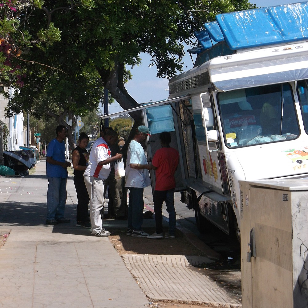 While the area was cleaned, some of the homeless ordered food from a truck next to the Neil Good Day Center.