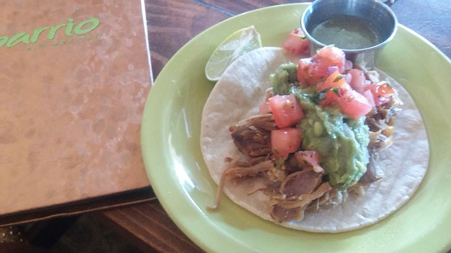 The carnitas tacos are street.