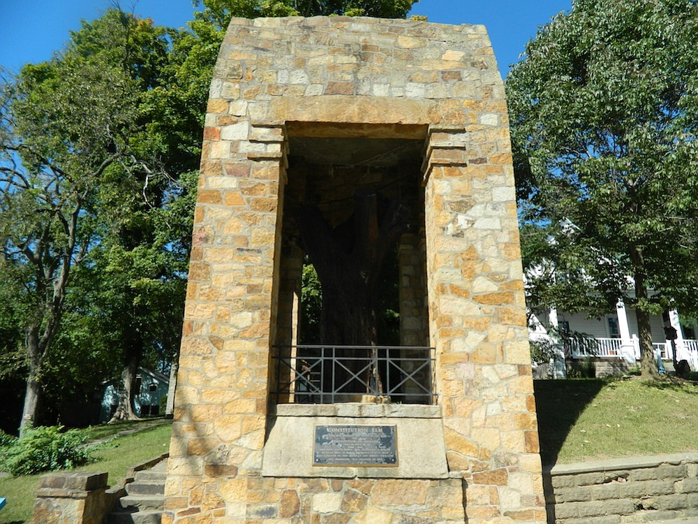Corydon's Constitutional Elm is preserved and surrounded by this stone monument.