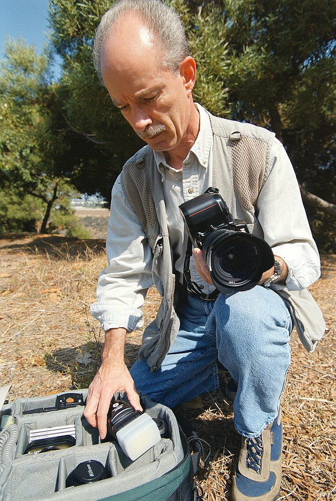 Bill Johnson is the manager of the Chula Vista PD Crime Lab and a forensic photographer.