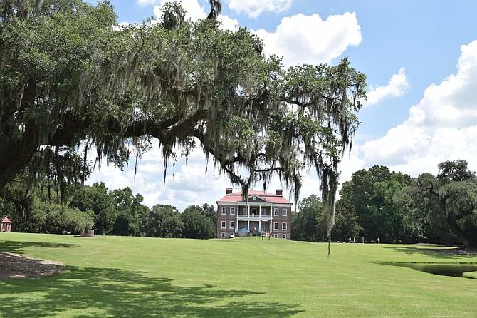 Drayton Hall, Charleston S.C. framed by Oak tree draped with Spanish Moss.