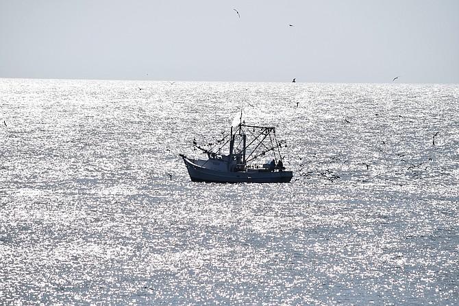 Early morning fishing boat off of Carolina Beach N.C.
