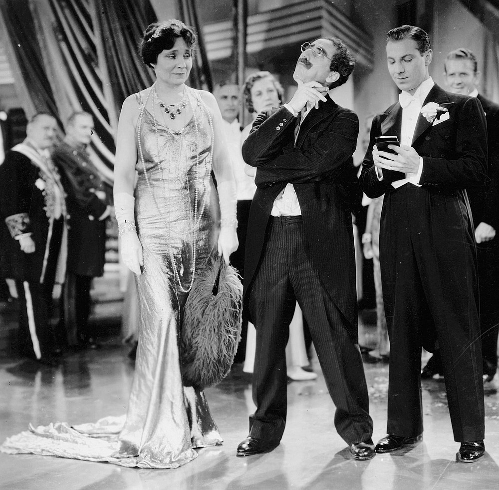 The perfect foil, Margaret Dumont, takes heat from Groucho and Zeppo.