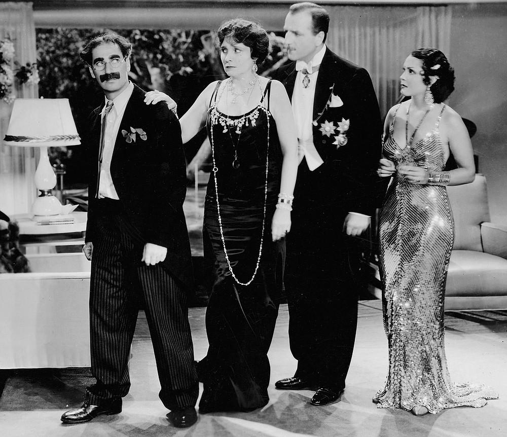 Firefly, Margaret Dumont, Louis Calhern, and Raquel Torres.