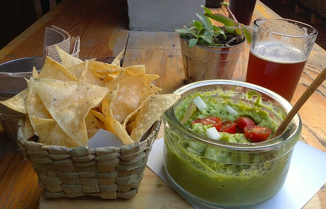 Guacamole appetizer and beer