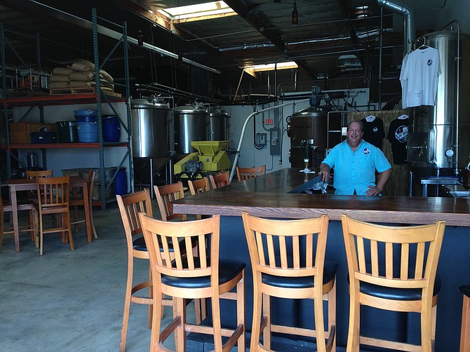 Bay Bridge co-founder Jim Shirey tends bar in his new tasting room.