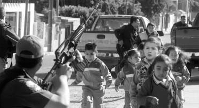 """September 24, 2007 — """"Gunmen fire automatic weapons from several vehicles, attacking a post manned by federales in the Francisco Villa neighborhood. The metal fence of a nearby school is destroyed by the storm of bullets."""" - Image by Oscar A. Martinez for Frontera"""