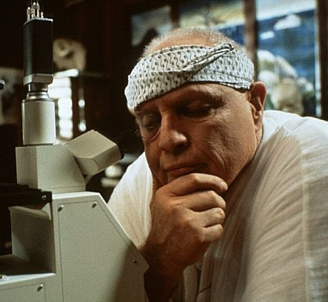 Dr. Moreau in his lab, musing on the notion that little boys are made of snakes and snails and puppy dog tails.