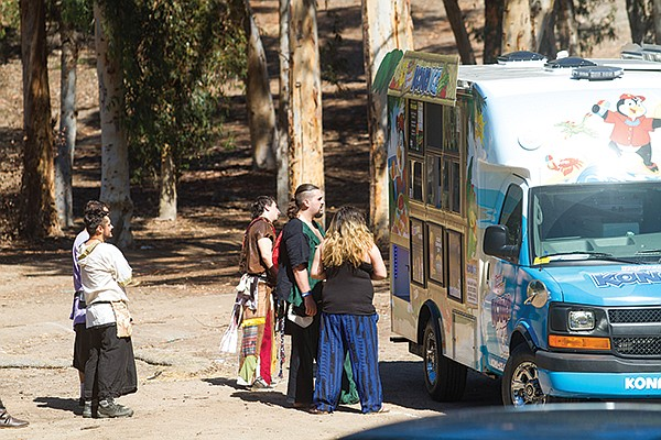 An enchanted chariot from some future civilization has pulled up to refuel the participants with frozen sweet treats