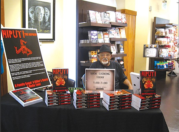 Joe Bonpensiero signing books at the Mob Museum in Las Vegas
