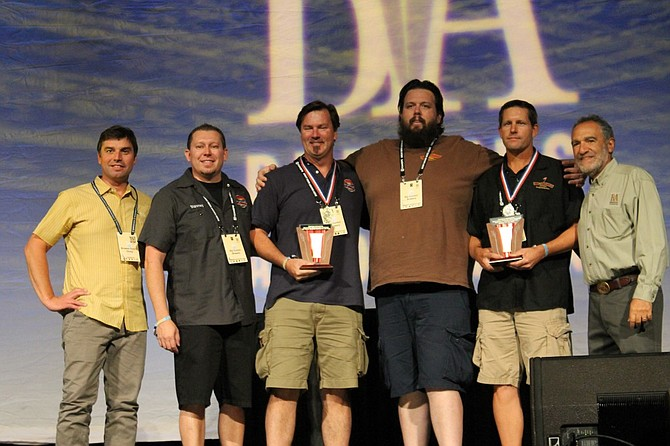 Paul Sangster and Guy Shobe hold trophies as Rip Current wins Very Small Brewery of the Year.