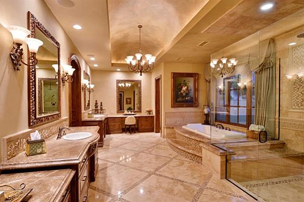 The bathroom has marble and travertine mosaic flooring