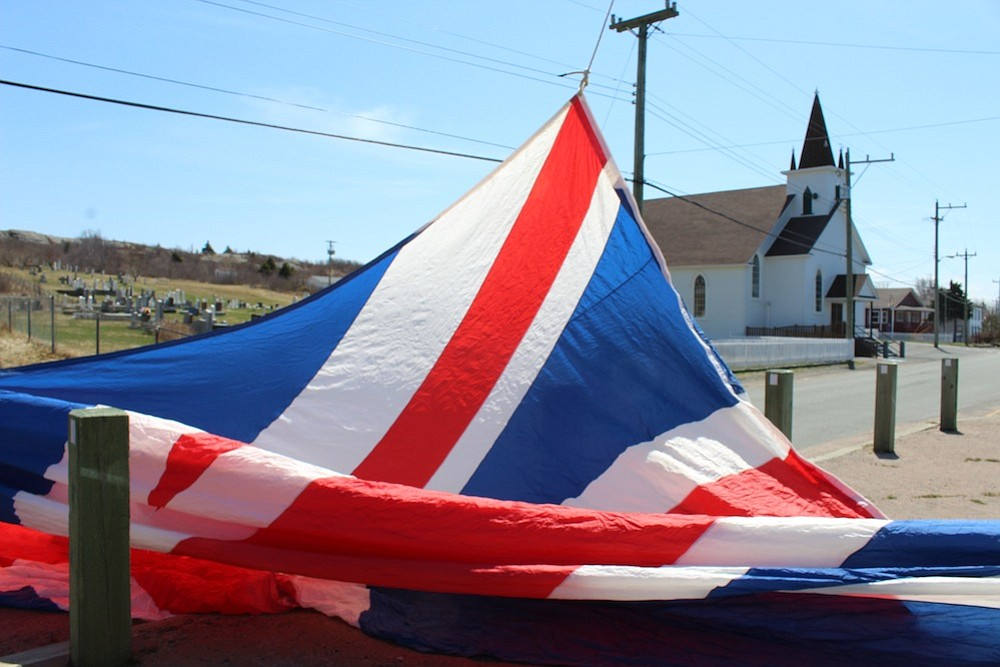 Giant Union Jack flag being unfurled in Cupids.
