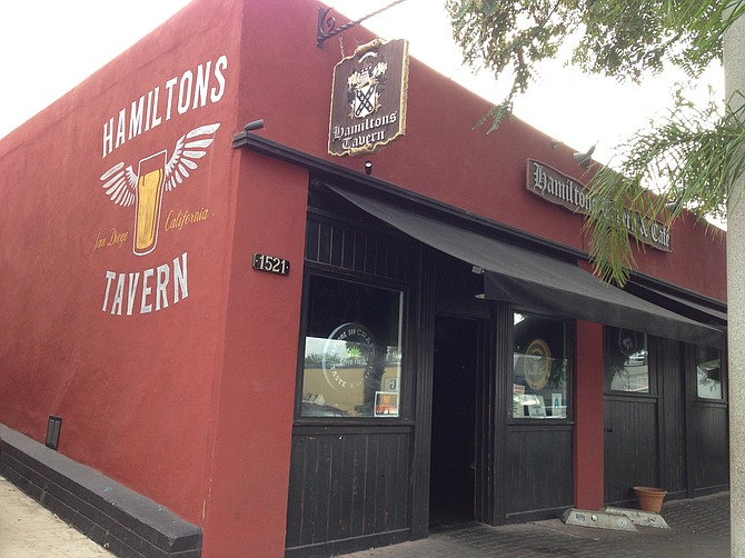 Hamilton's Tavern, known for burgers, potato sandwiches, and spicy wings. Also, beer.